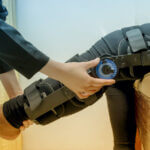 Physiotherapist adjust knee braces on patient 's leg,Rehabilitation for knee injury